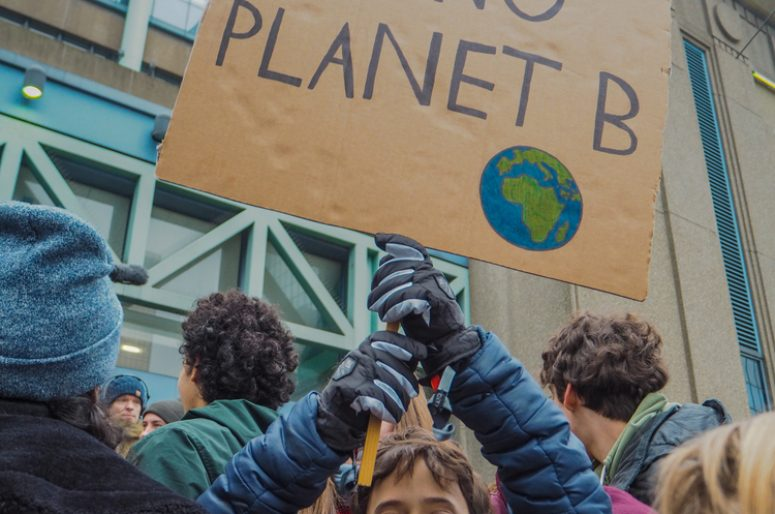 January 2019 - Brussels, Belgium: Young boy with a handmade poster with slogan in a protest march for climate change of the youth for climate movement