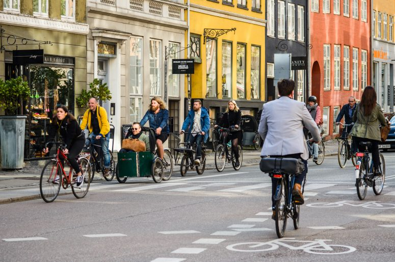 People riding bicycles Copenhagen old town, Denmark. Street styl