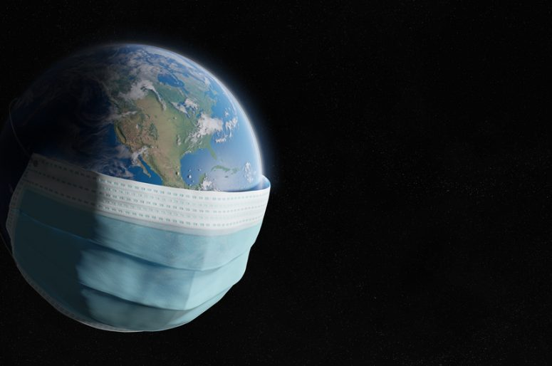 The world covered by a surgical mask from the Coronavirus pandem